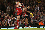 Wales wing George North collects the high ball under pressure from Charles Piutau.<br /> Dove men Series 2014<br /> Wales v New Zealand<br /> 22.11.14<br /> ©Steve Pope -SPORTINGWALES