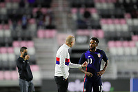FORT LAUDERDALE, FL - DECEMBER 09: Gregg Berhalter head coach of the United States gives direction to Kellyn Acosta #10 during a game between El Salvador and USMNT at Inter Miami CF Stadium on December 09, 2020 in Fort Lauderdale, Florida.