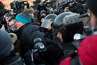 Police arrest a demonstrator in Lubyanka Square during an unsanctioned anti-Putin demonstration in Moscow, Russia.  Police arrested a number of protesters and opposition leaders.