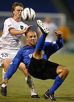 12 June 2004: Earthquakes Craig Waibel fights for the ball against MetroStars Midfielder Eddie Gaven at Spartan Stadium in San Jose, California.    Earthquakes defeated MetroStars, 3-1.  Mandatory Credit: Michael Pimentel / ISI