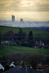 © Joel Goodman - 07973 332324 . 20/02/2014 . Manchester , UK . Landscape view across Manchester taken from Saddleworth near Oldham , featuring the city's iconic Beetham Tower on the left and the Piccadilly Tower and Town Hall to its right . Photo credit : Joel Goodman
