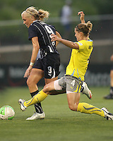 Allie Long #9 of the Washington Freedom is tackled by Jen Buczkowski #4 of the Philadelphia Independence during a WPS match on August 4 2010 at the Maryland Soccerplex, in Boyds, Maryland.Freedom won 2-0.