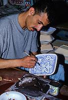 Ceramics, Nabeul, Tunisia.  Man Painting Design on Ceramic.  Le Caravane Workshop.