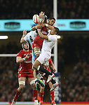Wales number 8 Taulupe Faletau and England centre Luther Burrell compete for the high ball.<br /> 2015 RBS 6 Nations<br /> Wales v England<br /> Millennium Stadium <br /> 06.02.15<br /> ©Steve Pope -SPORTINGWALES