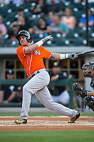 Dariel Alvarez (12) of the Norfolk Tides follows through on his swing against the Charlotte Knights at BB&T BallPark on April 20, 2016 in Charlotte, North Carolina.  The Knights defeated the Tides 6-3.  (Brian Westerholt/Four Seam Images)