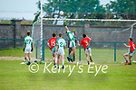 Ballyduff  keeper Kevin O'Connor see's the ball safely over the bar as Cian Goggin of St Michaels Foilmore bears down on him, in the County Senior football league.