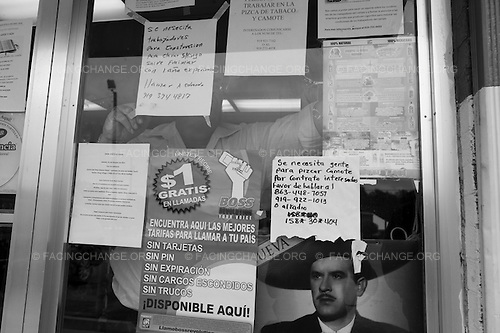 Dudley, North Carolina<br /> September 2011<br /> <br /> Frank Velazquez a community organizer with FLOC talks to farm workers and post flyers  inside local convenience stores. On September 18, FLOC members, community leaders, and activists came together for a rally to officially release a report and call on the tobacco industry to take action to end human rights abuses in their supply chain.
