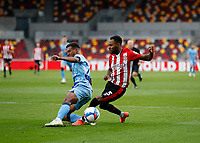 17th October 2020; Brentford Community Stadium, London, England; English Football League Championship Football, Brentford FC versus Coventry City; Sam McCallum of Coventry City challenges Rico Henry of Brentford