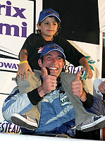 Max Papis and nephew after 3rd place finish at the Grand Prix od Miami at Homestead-Miami Speedway on Saturday, March 5, 2005.(Grand American Road Racing Photo by Brian Cleary)