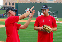 July 5, 2009: Pitching coach Bob Kipper (13) of the Greenville Drive talks mechanics with RHP Brock Huntzinger (24) prior to a game against the Savannah Sand Gnats at Fluor Field at the West End in Greenville, S.C. Photo by: Tom Priddy/Four Seam Images