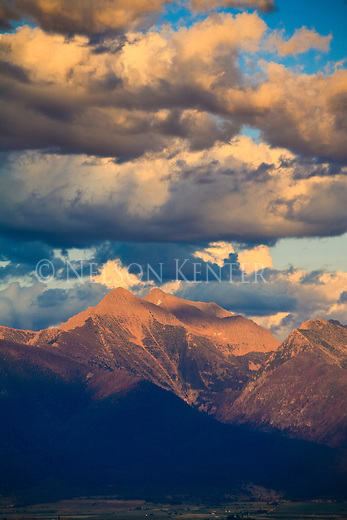 Mission Mountains and clouds at sunset