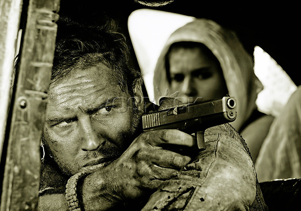 "NEW PICTURES TOM HARDY IN MAD MAX FURY ROAD MOVIE <br /> <br /> From director George Miller, originator of the post-apocalyptic genre and mastermind behind the legendary ""Mad Max"" franchise, comes ""Mad Max: Fury Road,"" a return to the world of the Road Warrior, Max Rockatansky.<br /> <br /> Haunted by his turbulent past, Mad Max believes the best way to survive is to wander alone. Nevertheless, he becomes swept up with a group fleeing across the Wasteland in a War Rig driven by an elite Imperator, Furiosa. They are escaping a Citadel tyrannized by the Immortan Joe, from whom something irreplaceable has been taken. Enraged, the Warlord marshals all his gangs and pursues the rebels ruthlessly in the high-octane Road War that follows.<br /> <br /> Tom Hardy (""The Dark Knight Rises"") stars in the title role in ""Mad Max: Fury Road""—the fourth in the franchise's history. Oscar winner Charlize Theron (""Monster,"" ""Prometheus"") stars as the Imperator, Furiosa. The film also stars Nicholas Hoult (""X-Men: Days of Future Past"") as Nux; Hugh Keays-Byrne (""Mad Max,"" ""Sleeping Beauty"") as Immortan Joe; and Nathan Jones (""Conan the Barbarian"") as Rictus Erectus. Collectively known as The Wives, Zoë Kravitz (""Divergent"") plays Toast, Riley Keough (""Magic Mike"") is Capable, Rosie Huntington-Whiteley (""Transformers: Dark of the Moon"") is Splendid, and supermodel Abbey Lee is The Dag, and Courtney Eaton is Fragile. Also featured in the movie are Josh Helman as Slit, Jennifer Hagan as Miss Giddy, and singer/songwriter/performer iOTA as Coma-Doof Warrior.<br /> <br /> Picture shows: Max ( Hardy) in a cene from the movie <br /> 75596<br /> EDITORIAL USE ONLY"