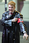 © Joel Goodman - 07973 332324 . 27/12/2016 . Wigan , UK . A man dressed as a Gestapo agent and wearing a Nazi Swastika armband . Revellers in Wigan enjoy Boxing Day drinks and clubbing in Wigan Wallgate . In recent years a tradition has been established in which people go out wearing fancy-dress costumes on Boxing Day night . Photo credit : Joel Goodman