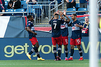 FOXBOROUGH, MA - JUNE 23: Tajon Buchanan #17 of New England Revolution celebrates his goal with teammate during a game between New York Red Bulls and New England Revolution at Gillette Stadium on June 23, 2021 in Foxborough, Massachusetts.