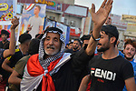 Iraqi protesters take part in an anti-government protest in Iraq's southern city of Nasiriyah in Dhi Qar province, on March 16, 2020. Photo by Wadaa al-Aumry