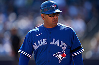 Toronto Blue Jays coach Luis Rivera (4) during a Spring Training game against the New York Yankees on February 22, 2020 at the George M. Steinbrenner Field in Tampa, Florida.  (Mike Janes/Four Seam Images)