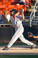 Derrik Gibson #18 of the Greenville Drive follows through on his swing against the Hickory Crawdads at  L.P. Frans Stadium May 8, 2010, in Hickory, North Carolina.  Photo by Brian Westerholt / Four Seam Images