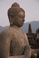 Borobudur, Java, Indonesia.  Statue of the Buddha near the Top of the Temple.