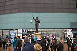 Coventry City 1 Birmingham City 1, 10/03/2012. Ricoh Arena, Championship. Fans walking past a statue to Jimmy Hill at the Ricoh Arena, before Coventry City hosted Birmingham City in an Npower Championship fixture. The match ended in a one-all draw, watched by a crowd of 22,240. Jimmy Hill was a former manager and director of Coventry widely credited with engineering the club's success in the 1960s and 1970s. Photo by Colin McPherson.