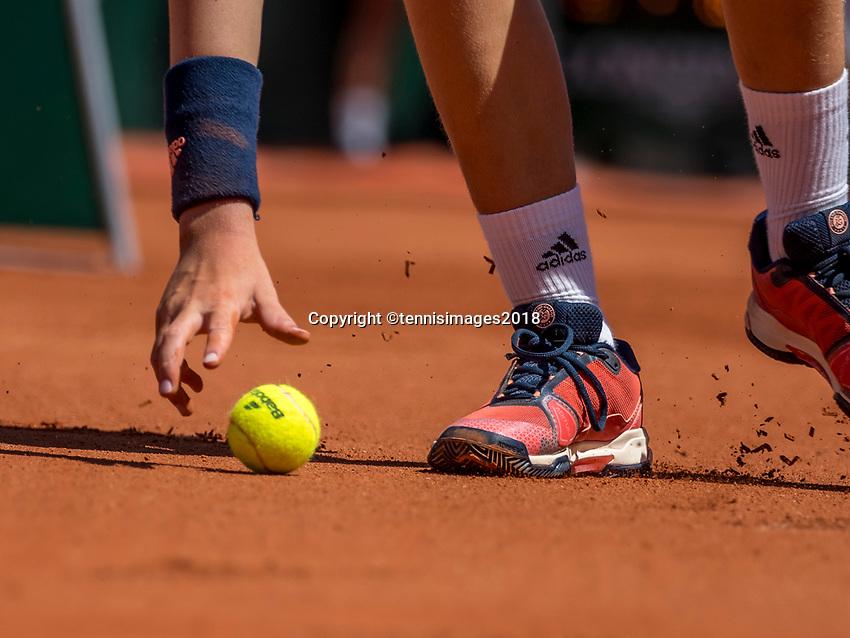 Paris, France, 27 May, 2018, Tennis, French Open, Roland Garros, ballboy picking up Roland Garros tennis ball<br /> Photo: Henk Koster/tennisimages.com