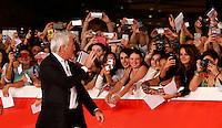 "L'attore statunitense Richard Gere saluta i fans dal red carpet per la presentazione del film ""Time Out of Mind"" al Festival Internazionale del Film di Roma, 19 ottobre 2014.<br /> U.S. actor Richard Gere greets fans as he walks on the red carpet to present the movie ""Time Out of Mind"" during the international Rome Film Festival at Rome's Auditorium, 19 October.<br /> UPDATE IMAGES PRESS/Riccardo De Luca"