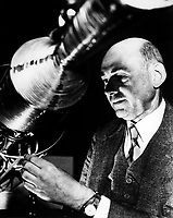 """Undated File Photo - Robert Goddard, a pioneer in rocket development, received patents for a multi-stage rocket and liquid propellants in 1914 and published a paper describing how to reach extreme altitudes six years later. That paper, """"A Method of Reaching Extreme Altitudes,"""" detailed methods for raising weather-recording instruments higher than what could be achieved by balloons and explained the mathematical theories of rocket propulsion. The paper, which was published by the Smithsonian Institution, also discussed the possibility of a rocket reaching the moon -- a position for which the press ridiculed Goddard. Yet several copies of the report found their way to Europe, and by 1927, the German Rocket Society was established, and the German Army began its rocket program in 1931.<br /> <br /> Goddard, meanwhile, continued his work. By 1926, he had constructed and tested the first rocket using liquid fuel. Goddard's work largely anticipated in technical detail the later German V-2 missiles, including gyroscopic control, steering by means of vanes in the jet stream of the rocket motor, gimbal-steering, power-driven fuel pumps and other devices.<br /> <br /> Image credit: NASA"""