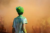 Boy Watching Crowd Celebrating Throwing Dye at Music Concert, Seattle Center, WA, USA.
