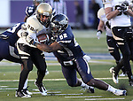 Nevada's James-Michael Johnson (52) tackles Idaho runningback Princeton McCarty (20) during the second half of an NCAA football game in Reno, Nev., on Saturday, Dec. 3, 2011. Nevada won 5-3. .Photo by Cathleen Allison