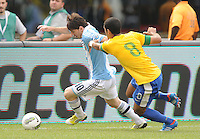 Argentina forward Lionel Messi (10) shields the ball from Brazil midfielder Romulo (8) The Argentina National Team defeated Brazil 4-3 at MetLife Stadium, Saturday July 9 , 2012.