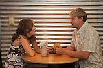 Stephie Scheetz and Jeff Leighton having coffee.