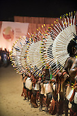 Karaja form a line wearing their distinctive white wheel-shap[ed feather headdresses during the International Indigenous Games, in the city of Palmas, Tocantins State, Brazil. Photo © Sue Cunningham, pictures@scphotographic.com 24th October 2015