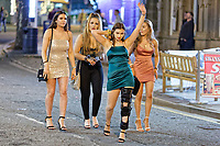 Pictured: A female reveller wearing a cast walks with friends down Wind Street, Swansea. Monday 31 December 2018 and Tuesday 01 January 2019<br /> Re: New Year revellers in Wind Street, Swansea, Wales, UK