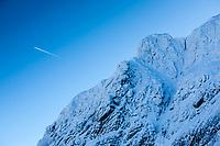Climbing team negotiating the infamous gap in the Tower Ridge, Ben Nevis, Scotland