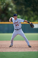 Detroit Tigers Luke Sherley (65) throws to first base during a Florida Instructional League game against the Pittsburgh Pirates on October 2, 2018 at the Pirate City in Bradenton, Florida.  (Mike Janes/Four Seam Images)