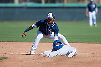 San Diego Padres shortstop Gabriel Arias (13) applies the tag to Sam McWilliams (9) as he slides into second base on a stolen base attempt during an Instructional League game against the Los Angeles Dodgers at Camelback Ranch on September 25, 2018 in Glendale, Arizona. (Zachary Lucy/Four Seam Images)