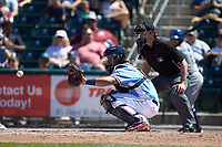 Lehigh Valley Iron Pigs catcher Jorge Alfaro (24) receives a pitch as home plate umpire Scott Costello looks on during the game against the Durham Bulls at Coca-Cola Park on July 30, 2017 in Allentown, Pennsylvania.  The Bulls defeated the IronPigs 8-2.  (Brian Westerholt/Four Seam Images)