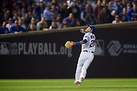 Chicago Cubs shortstop Addison Russell (27) catches a shallow popup in the outfield in the sixth inning during Game 3 of the Major League Baseball World Series against the Cleveland Indians on October 28, 2016 at Wrigley Field in Chicago, Illinois.  (Mike Janes/Four Seam Images)
