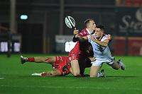 James Hume of Ulster is tackled by Ioan Nicholas of Scarlets during the Guinness Pro14 Round 09 match between the Scarlets and Ulster Rugby at the Parc Y Scarlets Stadium in Llanelli, Wales, UK. Friday 23 November 2018