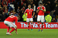 (L-R) Aaron Ramsey, Neil Taylor and Ashley Williams of Wales look dejected after the final whistle during the 2018 FIFA World Cup Qualifier between Wales and Serbia at the Cardiff City Stadium, Wales, UK. Saturday 12 November 2016