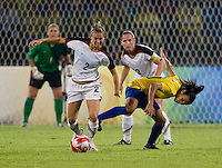 Heather Mitts, Marta, Christie Rampone. The USWNT defeated Brazil, 1-0, to win the gold medal during the 2008 Beijing Olympics at Workers' Stadium in Beijing, China.