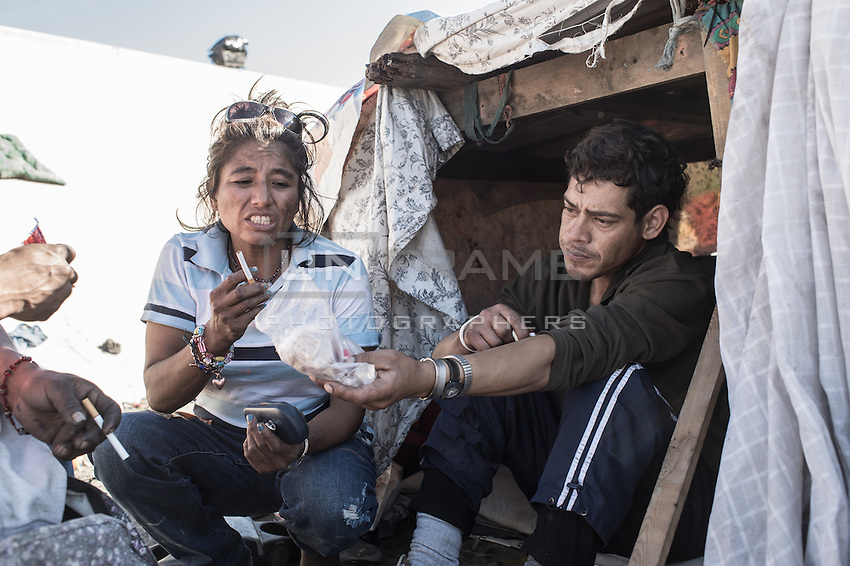 A young couple that has been deported from the USA and separated from their daughter is living in poor condition in the canal, el Bordo. Tijuana, Mexico. Jan 05, 2015.