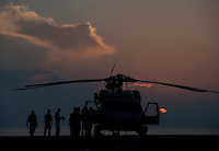 120404-N-DR144-008 INDIAN OCEAN (April 4, 2012) Sailors assigned to Helicopter Anti-Submarine Squadron (HS) 15 finish maintenance on an HH-60H Seahawk as the sun sets on the flight deck aboard the Nimitz-class aircraft carrier USS Carl Vinson (CVN 70). Carl Vinson and Carrier Air Wing (CVW) 17 are deployed to the U.S. 7th Fleet area of operations. (U.S. Navy photo by Mass Communication Specialist 2nd Class James R. Evans/Released)