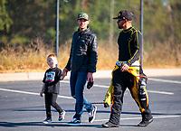 Oct 14, 2019; Concord, NC, USA; NASCAR Cup Series driver Kyle Larson (left) talks with NHRA funny car driver J.R. Todd during the Carolina Nationals at zMax Dragway. Mandatory Credit: Mark J. Rebilas-USA TODAY Sports