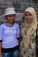Borobudur, Java, Indonesia.  Two Indonesian Muslim Women, Mother and Daughter, Visiting Borobudur Temple.