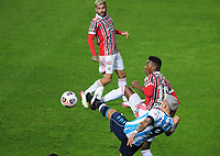 20th July 2021; Buenos Aires, Argentina;  Racing's Enzo Copetti challenges Léo Pelé of São Paulo, during the match between Racing and São Paulo, for the Libertadores 2021 Round of 16, at Estádio Presidente Perón