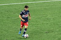 FOXBOROUGH, MA - MAY 22: Carles Gil #22 of New England Revolution brings the ball forward during a game between New York Red Bulls and New England Revolution at Gillette Stadium on May 22, 2021 in Foxborough, Massachusetts.