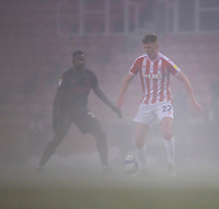 29th December 2020; Bet365 Stadium, Stoke, Staffordshire, England; English Football League Championship Football, Stoke City versus Nottingham Forest; Sam Clucas of Stoke City in the thick fog