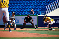 Michigan Wolverines first baseman Jesse Franklin (7) holds Josh White (3) on as umpire Mark Spicer looks on during a game against Army West Point on February 17, 2018 at Tradition Field in St. Lucie, Florida.  Army defeated Michigan 4-3.  (Mike Janes/Four Seam Images)