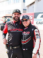 Feb 23, 2020; Chandler, Arizona, USA; NHRA top fuel driver Billy Torrence (right) with crew chief Bobby Lagana during the Arizona Nationals at Wild Horse Pass Motorsports Park. Mandatory Credit: Mark J. Rebilas-USA TODAY Sports