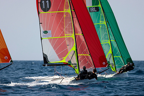 Robert Dickson and Sean Waddilove (green spinnaker) lead Ryan Seaton and Seafra Guilfoyle on a downwind leg in Lanzarote this week Photo: Sailing Energy